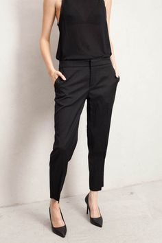 Perfectly fitting cropped black pants that don't stunt the legs.