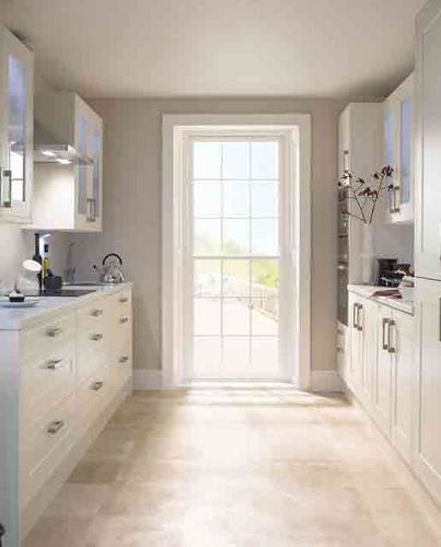 In a galley kitchen, create a view at the far end, whether with a door or large window - doing so will open the room up and help it to feel brighter and larger.