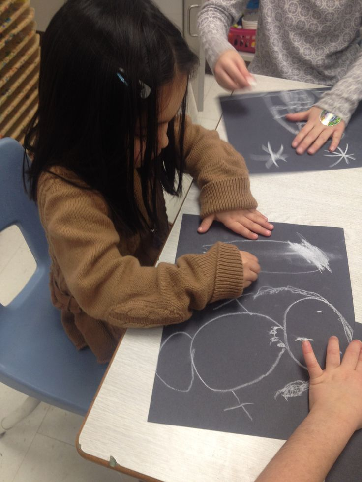 """Drawing a """"snowy night"""" using black construction paper and white chalk! Not only is this activity allowing the child to be creative, but enhancing her fine motor skills by holding a piece of chalk using the """"pincer grip""""   Whenever you are using writing materials, even during art activities, the child is strenghtening their finger muscles!"""