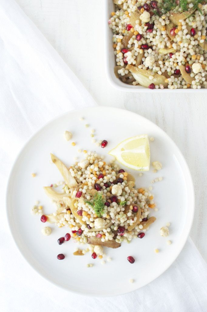 Israeli couscous summer salad with fennel, pomegranate seeds and hazelnuts.