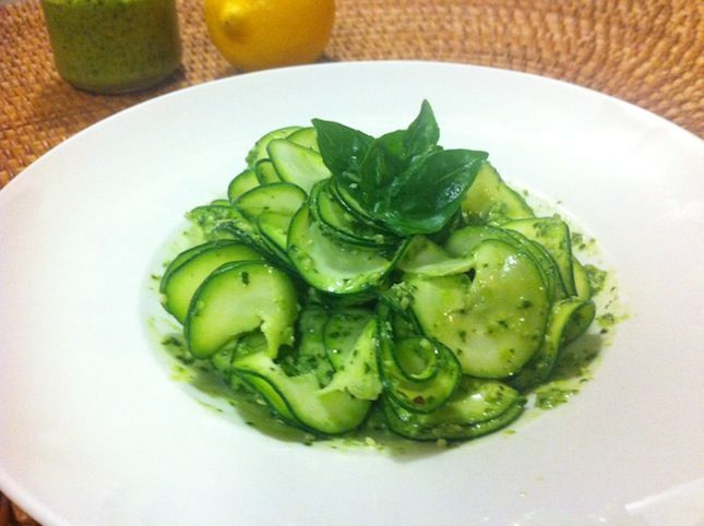 Raw zucchini pasta with a luscious basil pesto. A light, healthy dish perfect for summer.