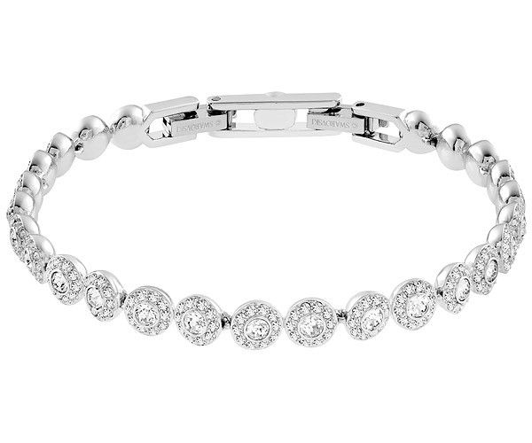 Pure, timeless sophistication. This rhodium-plated bracelet features a row of round clear crystals, each one framed in sparkling clear crystal pavé.... Shop now