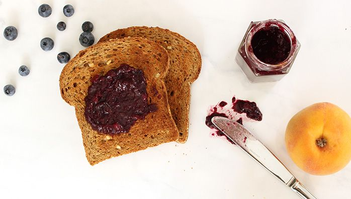 10 minutes peach blueberry jam on sprouted grain bread. Sugar free!