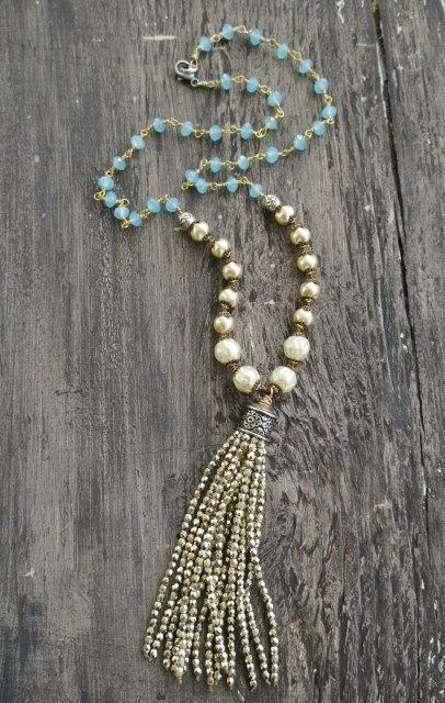 """Sparkly gold pearl tassel necklace Bohemian by slashKnots on Etsy- A vermeil wire wrapped chain of opalescent chalcedony stones along with knotted cream glass pearls holds a super lush metallic gold glass tassel. Lots of movement and shine! Artisan sterling silver and gold fill accents. Dress it up or down! Great holiday party necklace :) Measures 24"""" with a 4 1/4"""" tassel drop. Sterling lobster closure."""