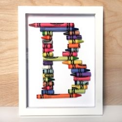 Learn how to create your own crayon alphabet!  Can't you just see these looking adorable in a kid's room, maybe with their full initials?