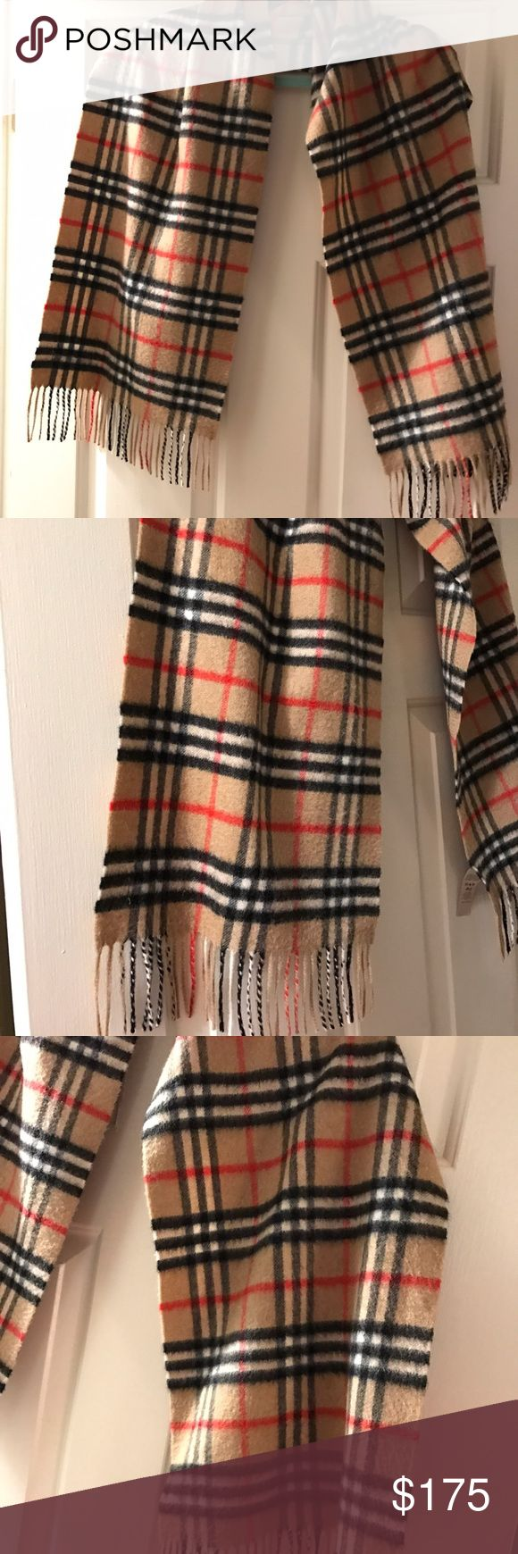 """Authentic Burberry Camel Scarf Cashmere 100% Authentic Burberry scarf. Unlike a lot being sold on here. This scarf is in excellent condition. No tears or holes. Smoke free home. 100% Cashmere so it is extremely soft and warm. Measurements are estimated to be about 60"""" long by 12"""" wide. Burberry Accessories Scarves & Wraps"""