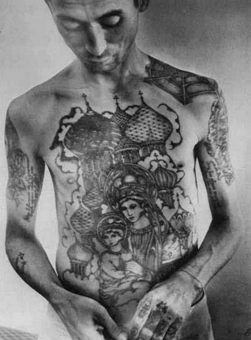 Russian Prison Tattoo - Church on Chest   During the Soviet era it was common to see pictures of Lenin or Stalin (with or without horns) on prisoner's chests. One theory is that prisoners had these pictures on their chests or abdomens because the prison guards couldn't shoot the USSR founding fathers' image.: