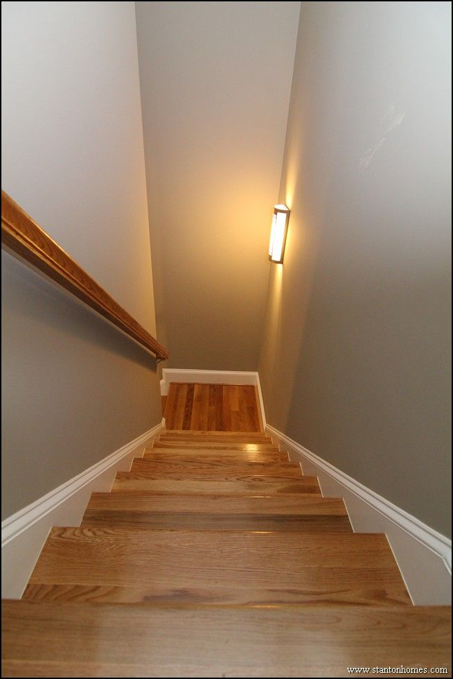 Enclosed hardwood staircase to second story bonus room.