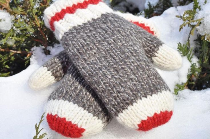 "Not as much fun as carrying a sock monkey around with you, but definitely the next best thing to have ""on hand""! These ""grown up"" Sock Monkey Mittens are designed and hand knit by me using 100% pure wool. Colours featured are dark brown, winter white and red. Size: Women's (S-M) 9 1/4""(24cm) long, 3.5"" (9cm) wide. Hand wash in cold water, dray flat. Hand made in a smoke/pet free home. Made in CANADA! This mittens will be knit specifically for you after your order has been received."
