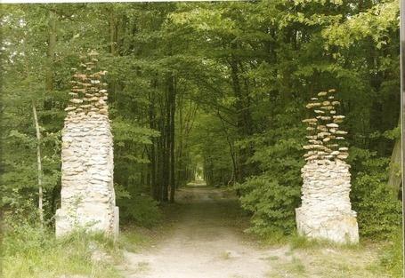 "Cornelia Konrads: ""The gate"", 2004, SenArt en Forêt, Fontainebleau, France,  Installation on the remains of two gate posts, stones, iron, concrete 3.5 x 5.0 x 0.8 m"