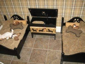 "Most well-designed ""Dog bedroom"" I've ever seen. It's practical (tile floors for easy cleanup, chest storage box for toys and extra items), comfy (nice cushiony low beds with pillows), and stylish (plaid wallpaper, paw print headboards). I love it! Definitely want to have this for my dog(s)."