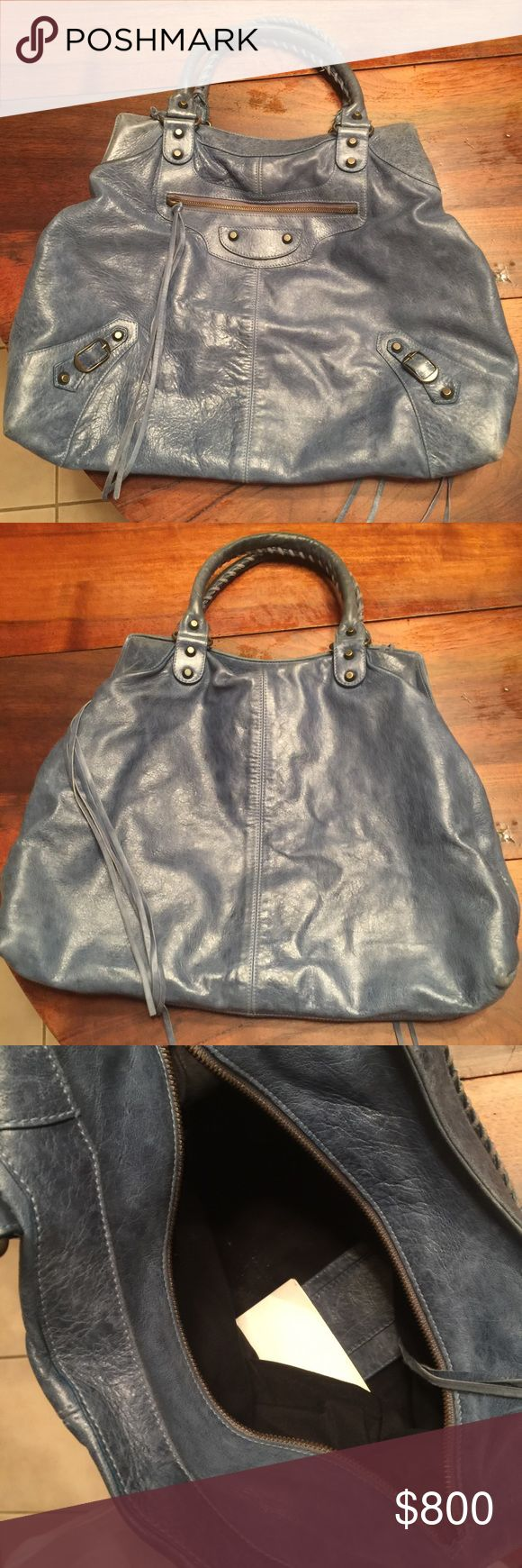 Balenciaga handbag Authentic balenciaga handbag (poshmark authenticates everything over $500) / used but in good condition/ large/ very stylish goes with anything/ beautiful blue color / please ask any questions you may have/ Balenciaga Bags Hobos