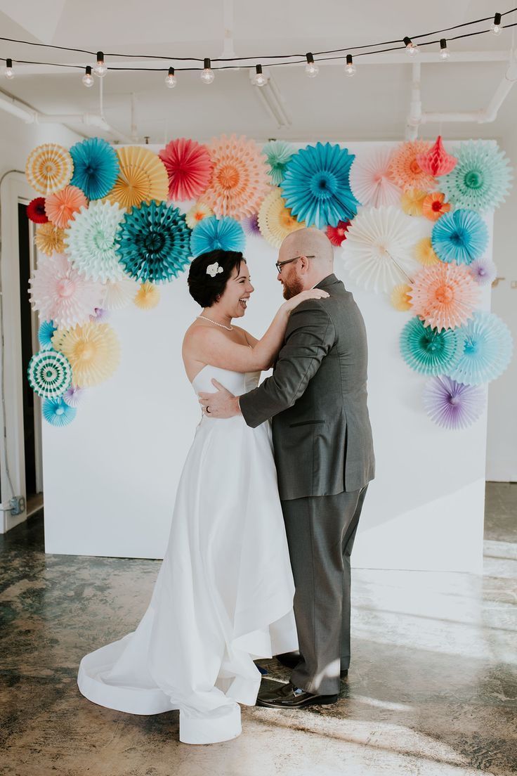 Colorful wedding backdrop with paper fans