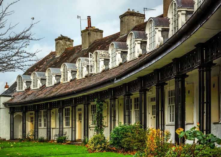 This is a lovely row of houses at Port Sunlight Village. The late 19th Century village was built by William Hesketh Lever (later Viscount Leverhulme) to house his soap factory workers at Lever Brothers which eventually turned into the global giant Unilever. The village is set in 130 acres with 900 houses, most of which are Grade II listed. Over 30 different architects were employed in the building of the village so it is lovely mix of styles. I