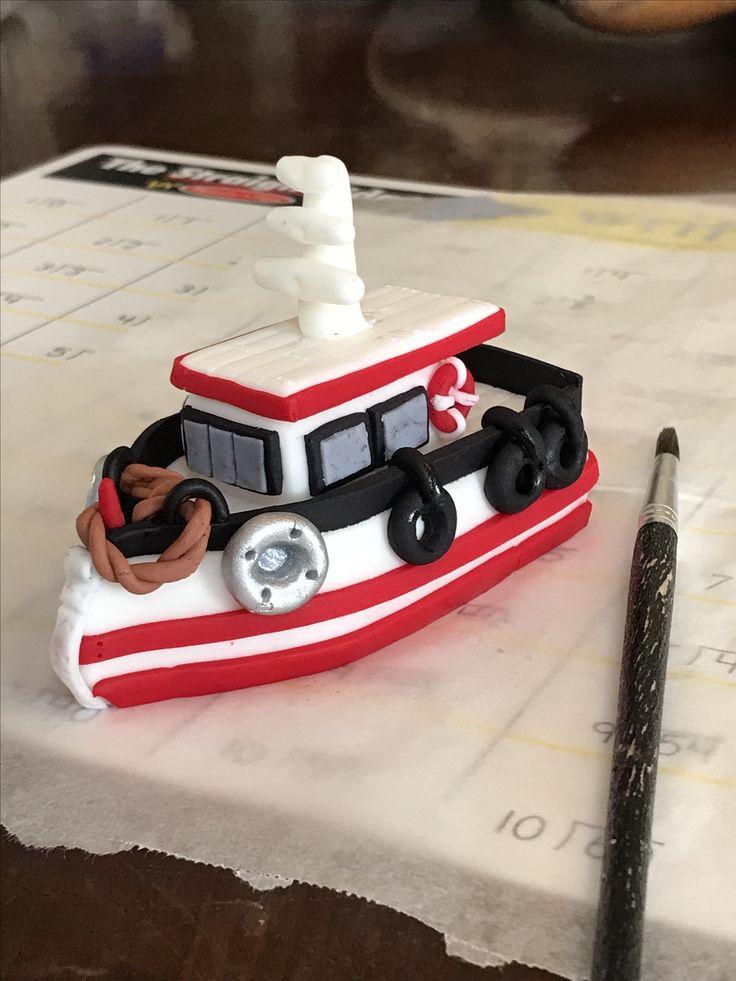 Fondant fishing boat cake topper