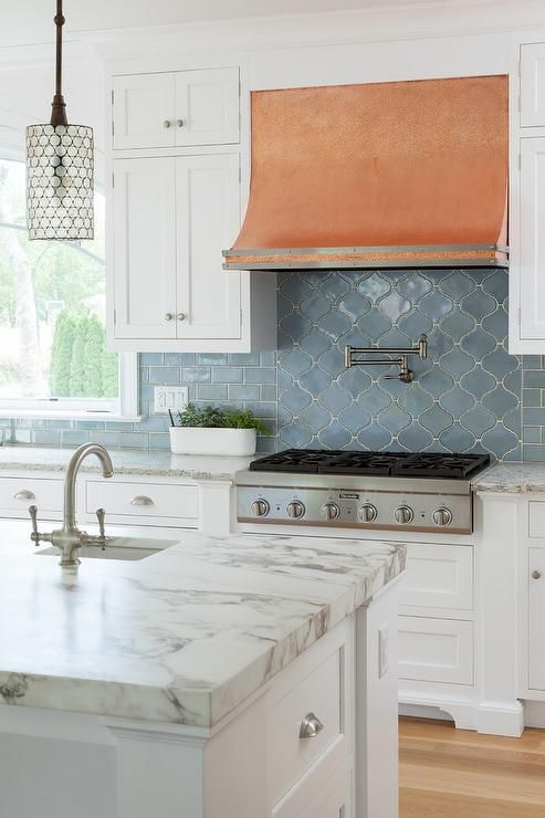 White And Blue Kitchen Features White Shaker Cabinets Paired With Pental Quartz Tobacco Countertops And A Arabesque Tile Backsplashcopper