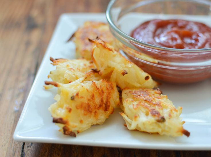 Cheesy Baked Homemade Tater Tots are a delicious side dish recipe for burger night.  These homemade baked tater tots skip all of the lengthy boiling and grating of potatoes to save time.  An easy quick recipe Cheesy Baked Homemade Tater Tots are kid friendly and mom approved!