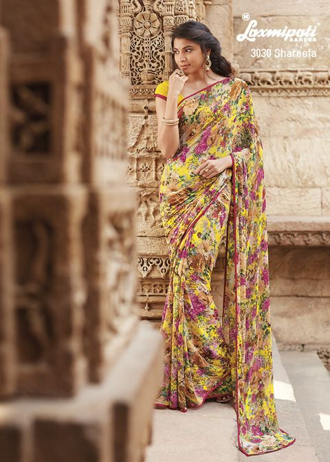 This yellow colored georgette saree look pretty with multi colored flowery prints.