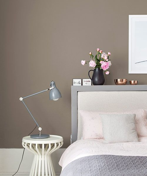 Moody gray-brown walls have a low-drama effect in a light-filled bedroom. Devine Color's Devine Lino