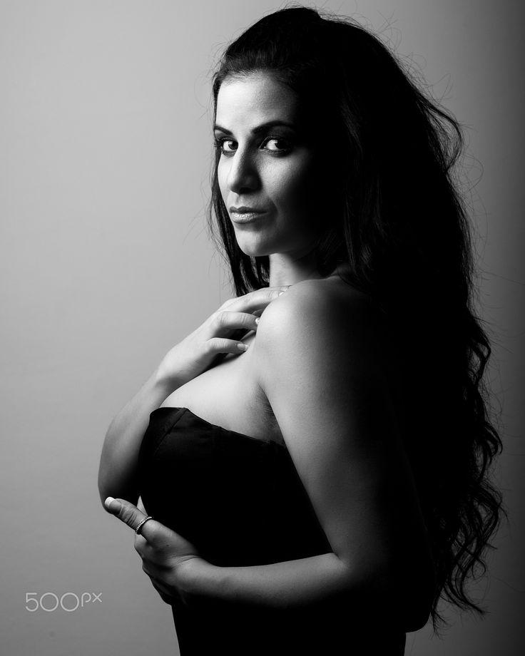 Stephania - Black & white portrait in low-key mode from Stephania's photoshoot.  Photo by Giorgos Zondi_ Model Stephania_  Follow me on FB (https://www.facebook.com/giorgos.zondi) Follow me on INSTAGRAM (https://instagram.com/giorgos.zondi/)