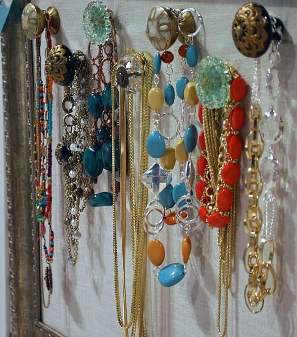 I want to make this jewelry organizer. It looks like drawer knobs screwed onto a fabric covered board inside a frame. Shouldn't be too difficult.