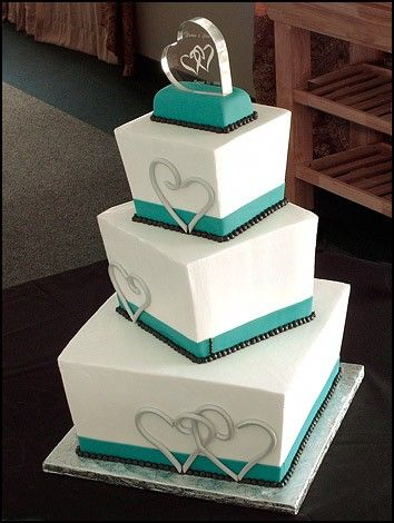 Love this cake!!! wedding cake, square, 3-tier w/ teal and black design and hearts.  Shown with our Entwined Hearts Personalized Topper (http://www.weddingfavorsunlimited.com/engraved_entwined_heart_acrylic_cake_top.html)
