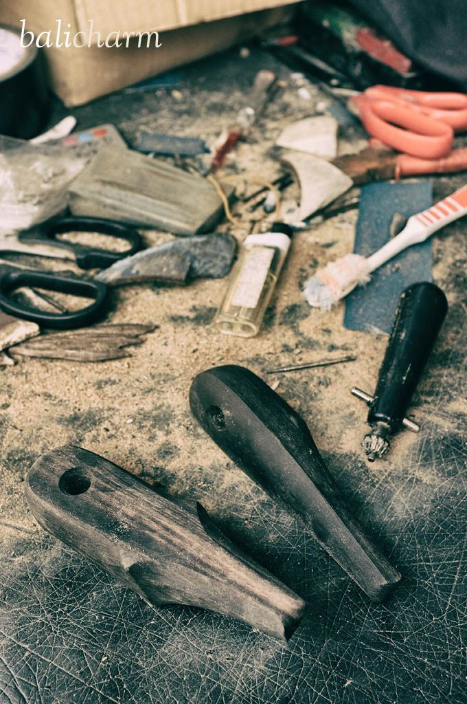Woodcarving process of ebony hashish and marijuana pipes hand-carved in Bali, Indonesia.