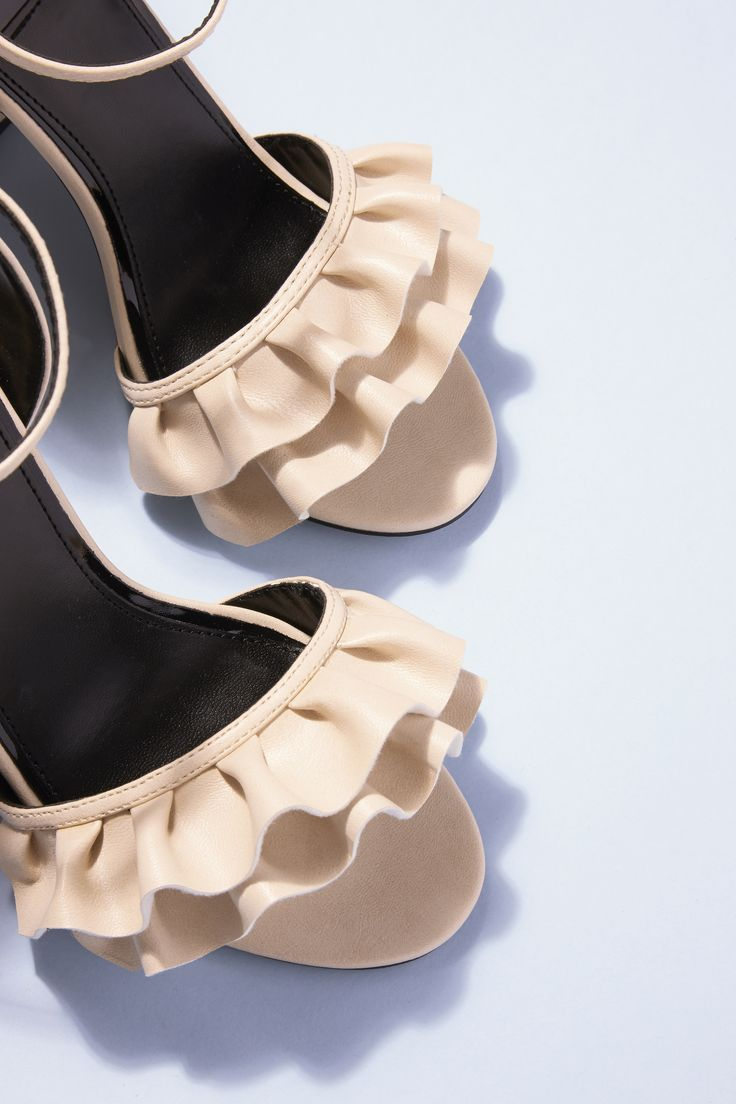 Elevate your going-out look with a pair of wear-with-everything heels in a neutral shade. Frill-seekers are sure to fall in love with the ruffle detail on Miss Selfridges's strappy sandals. With a chunky heel and ankle strap, they're party-practical, as well as being pretty, too.