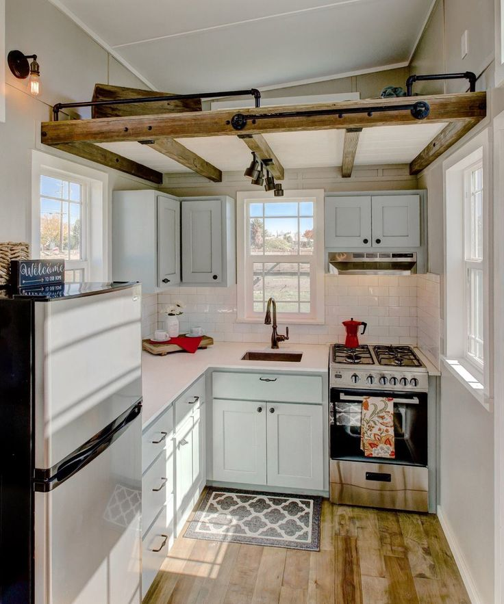 The full kitchen comes with quartz countertops, custom painted Alder cabinets, a freestanding propane range, and an apartment size refrigerator.  High-end Moen plumbing fixtures are used in the kitchen and bathroom.