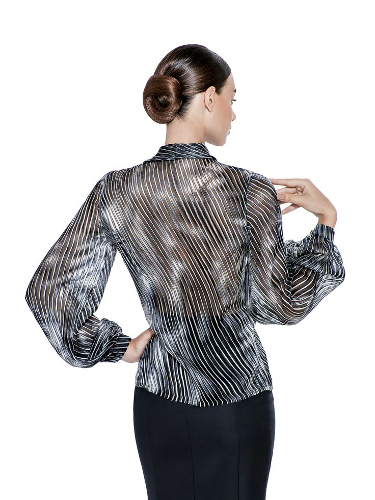 The seventies provided inspiration for the SS17 collection, this black and white silk stripe blouse with bell cuffed sleeves and bow neckline is a chic case in point. A perfect option to go from day to night, so style the bow to add a personal touch. Fabric imported from Hong Kong: 30% Silk with burn out print 70% Viscose  Washcare: Dry clean MADE IN EUROPE