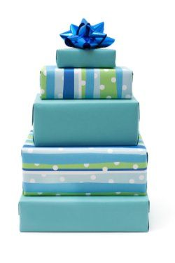 Centerpiece idea: Cover boxes of various sizes and shapes in decorative papers and affix a ribbon on top of each.
