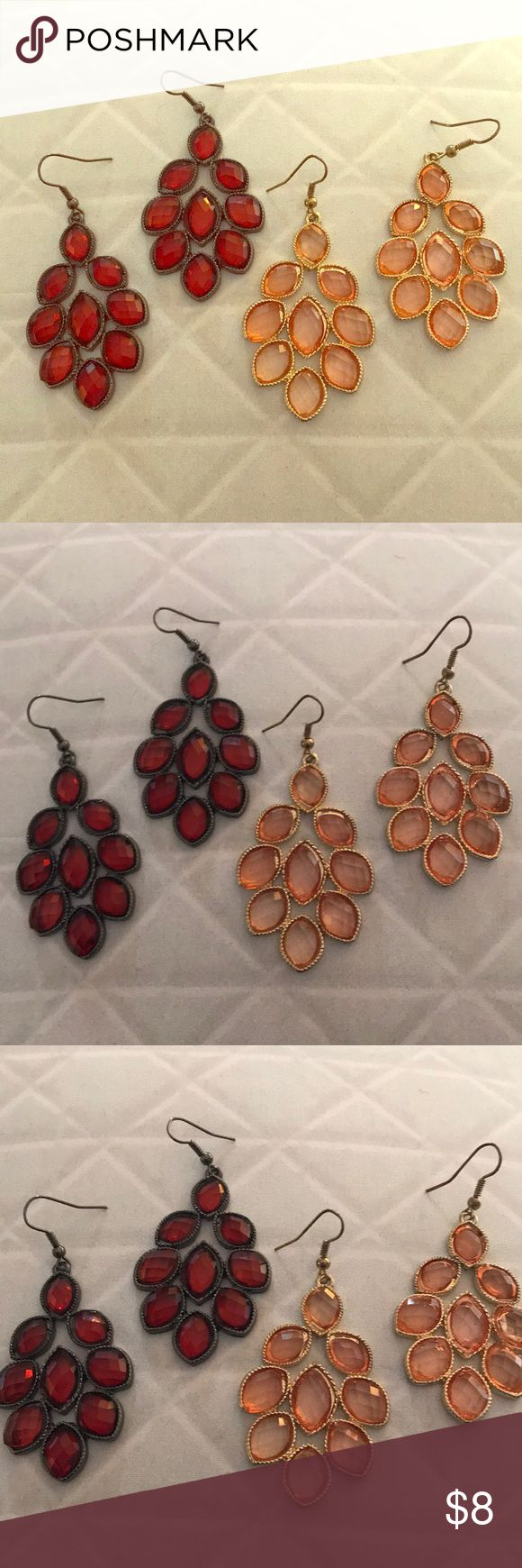 Red & Orange Chandelier Style Earring Bundle These adorable earrings are perfect for any occasion, whether work, a night out, or to add some flare to a casual day! Both pairs are the same style; I am unsure of the metal type used in either. The red feature black metal accent, and the orange feature gold metal accent.   This bundle has very slight signs of wear, as photoed. Please note the first photo is filtered to lighten the area and make for a better view of the item, due to lighting…