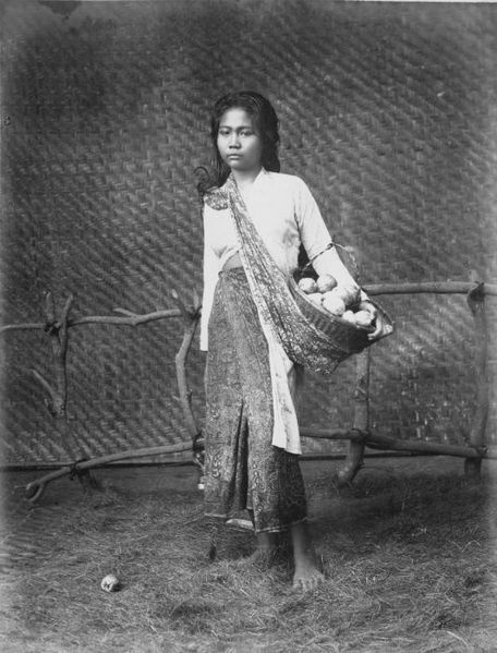 Indonesia. Studio portrait of a jambu bol fruit seller. 1870-1900