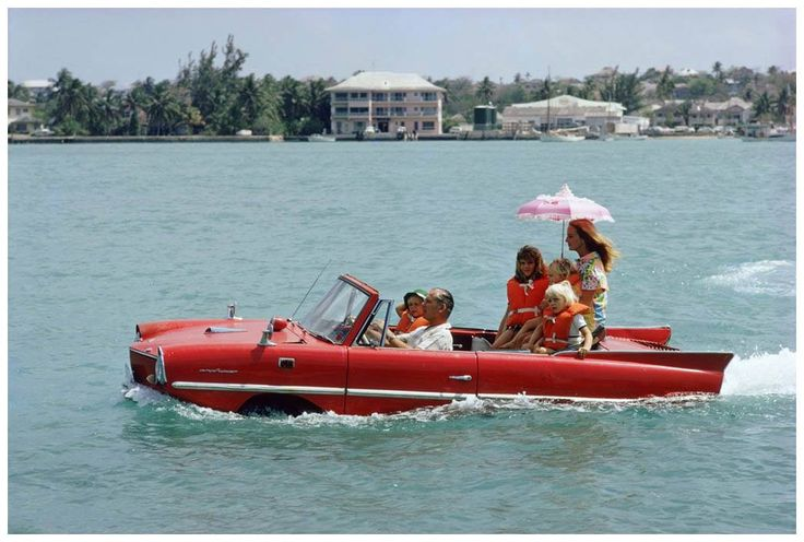 Kevin McClory and his Wife, Bobo Segrist, in the Amphicar at Nassau, 1967.