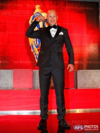 Gary Ablett of the Gold Coast Suns is presented with the 2013 Brownlow Medal during 2013 AFL Brownlow Medal count at the Crown Palladium, Melbourne on September 23, 2013. (Photo: Lachlan Cunningham/AFL Media)
