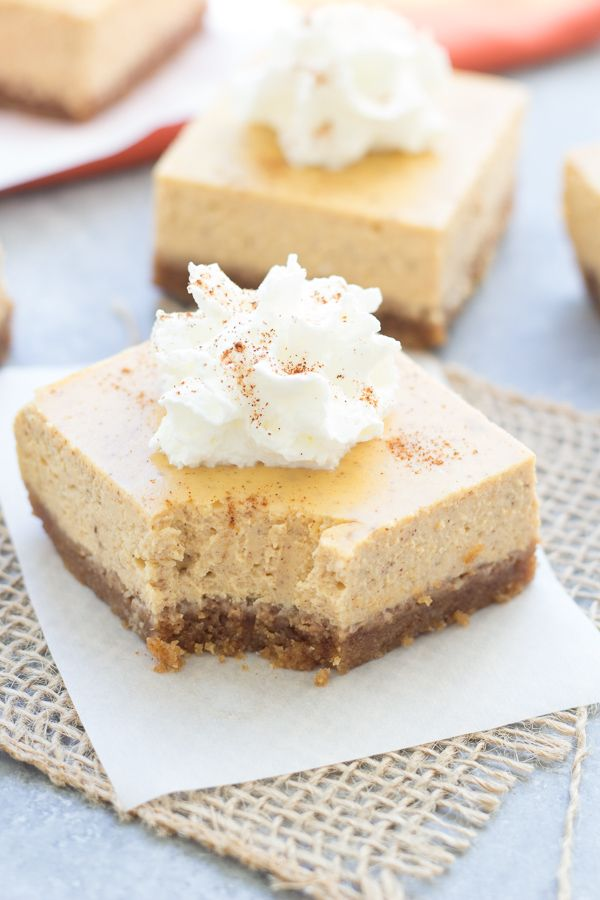 These Pumpkin Greek Yogurt Cheesecake Bars are the perfect treat to welcome the fall season! Light, creamy pumpkin spiced cheesecake tops a brown sugar, graham cracker and pecan crust.