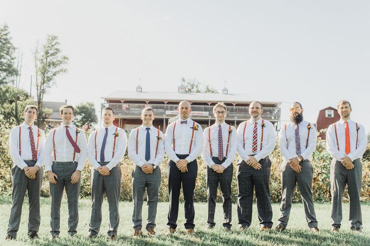 © Mallory McClure Photography | Central PA Wedding Photographer | Fine Art Wedding Photography, Romantic and Authentic Wedding Photography, Central PA Weddings and Reception Venues, Vineyards at Hershey Wedding, Hershey wedding, Vineyard wedding, photo of groom and groomsmen standing in vineyard, navy blue and orange wedding, mix and match groomsmen looks, groomsmen style, patterned ties and suspenders, Fall wedding