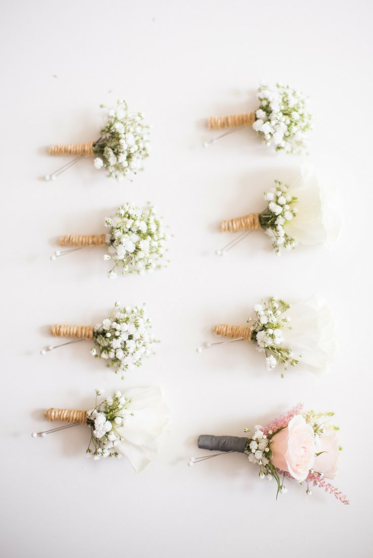 So simple and pretty! Grooms men's boutonnieres with baby's breath, and a rose for the groom
