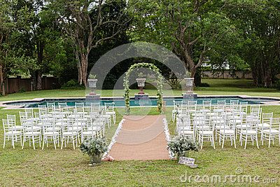 Wedding decor setup chairs ceremony on grass lawn cutlery glasses table on porch veranda at private home mansion