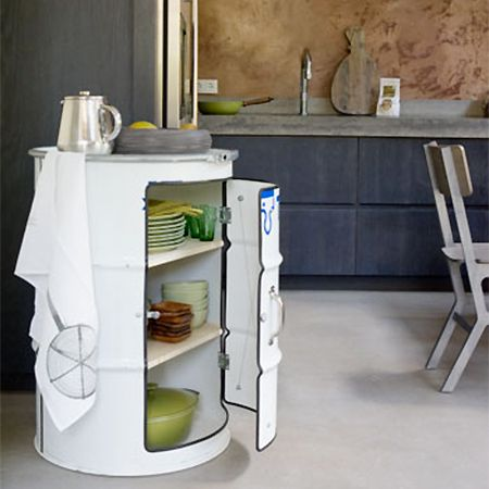recycled steel olive oil drum for kitchen storage cabinet - What a way to add character to a kitchen! An olive oil drum is cleaned and re-purposed into a kitchen cabinet to provide storage. - See more at: http://www.home-dzine.co.za/crafts/craft-recycled-kitchen.htm#sthash.PhT8JNrj.dpuf