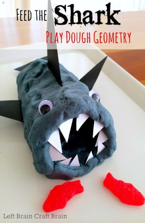 Play a fun game of Feed the Shark with play dough, paper and gummy fish and learn a bit about triangle geometry at the same time.  Celebrate #SharkWeek!