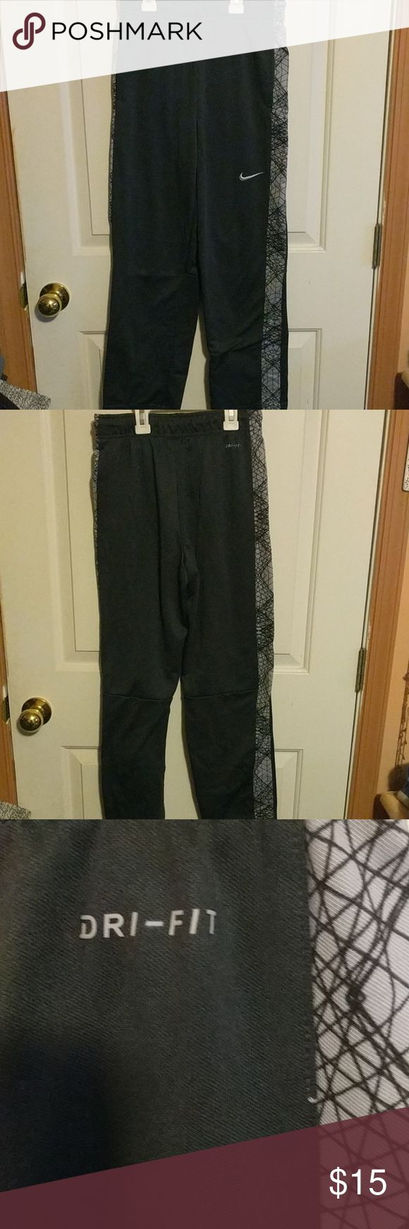 Boys Nike Gym Pants Slightly used boys Nike dri fit gym pants.  Thin fleece lining inside. 100% polyester Nike Bottoms Casual