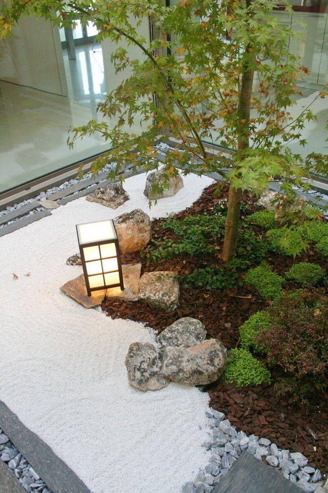 fotos de jardines de piedra de estilo jardin zen moderno