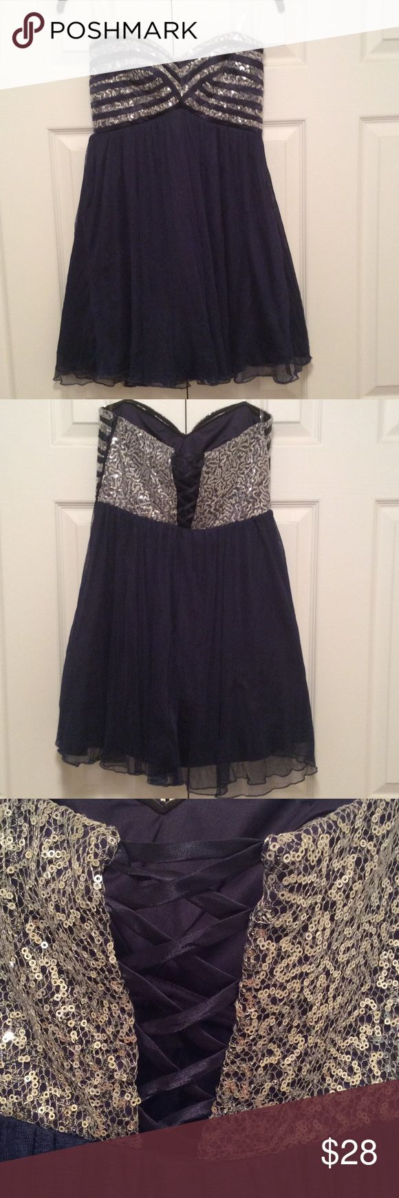 Sequin navy blue prom dress size 7 Jr strapless Sequin navy blue prom dress size 7 juniors worn once excellent condition corset back, strapless Sequin Hearts Dresses Prom