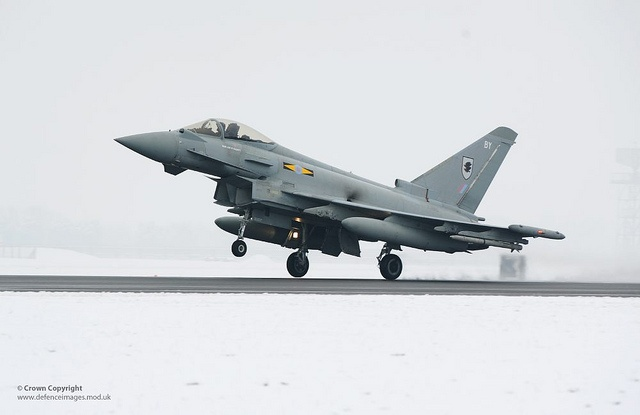 An 11 Squadron Typhoon aircraft comes into land after a sortie at Royal Air Force Coningsby in Lincolnshire. Such sorties enable front line Typhoon pilots to maintain their high standard of flying and combat skills.    The Typhoon force at Coningsby maintains Britain's Quick Reaction Alert, ready to launch in just a few minutes to intercept hostile or suspicious aircraft.