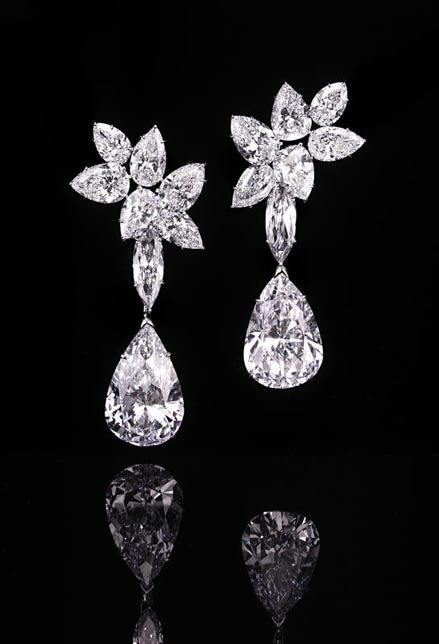 A pair of Harry Winston diamond ear pendants with two detachable pear-shaped diamonds weighing 14.85 and 14.59 carats sold for $3,936,342.