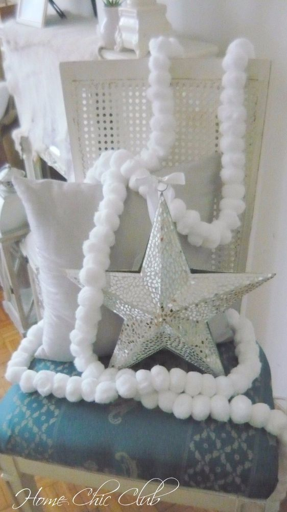 She grabs 50 cotton balls. What they become? I love this Christmas idea!