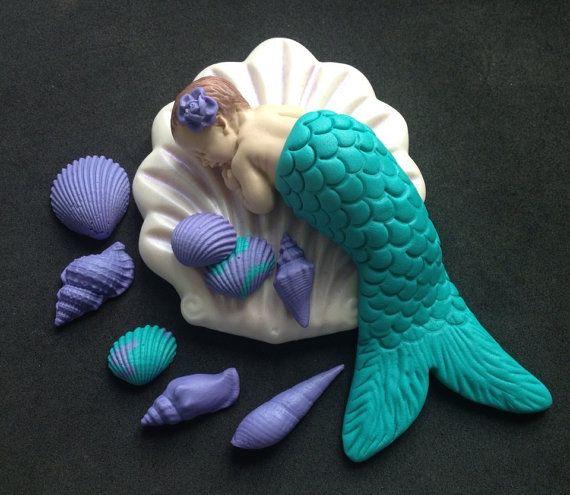 Fondant edible baby Mermaid lying on a sea shell cake topper