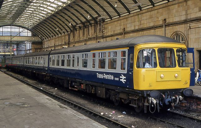 A Trans-Pennine set with a spruced-up E51957 leading waits to leave Hull Paragon with a service to Manchester Piccadilly on 29th September 1982.