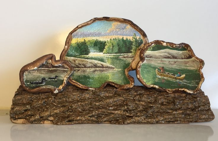 This oil painting is inspired by some of my ancestry: French-Canadian voyageurs. The scene is painted across a trio of artist's conks (bracket fungus) and securely attached to a hardened and preserved piece of tree bark.
